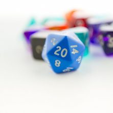 Macro shot of twenty sided dice with other dice