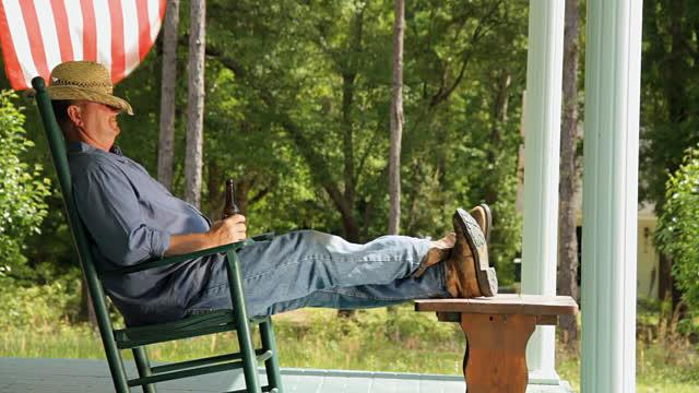 Image result for Man resting in porch on rocking chair with beer
